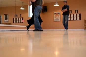 Tango teacher, Mike Eblen instructs an intermediate-level pair at SE Portland's Dance with Joy Studios.