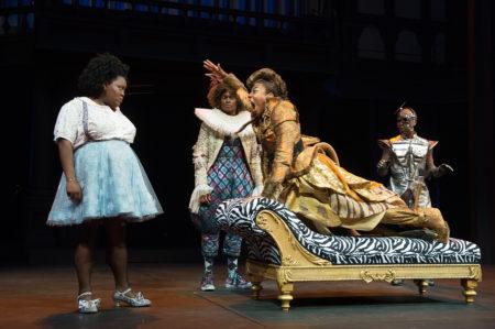 Lion (Christiana Clark) tries not to appear cowardly when she meets Dorothy (Ashley D. Kelley), Scarecrow (J. Cameron Barnett) and Tin Man (Rodney Gardiner). Photo: Jenny Graham, Oregon Shakespeare Festival