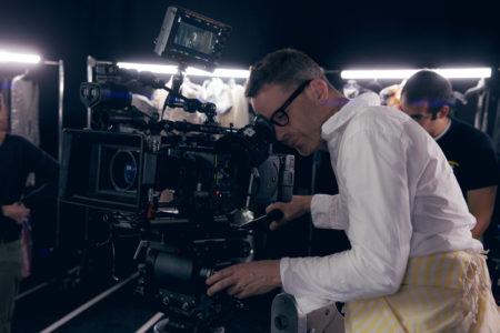 "Director Nicolas Winding Refn on the set of ""The Neon Demon."""