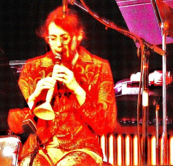 """Lisa Lipton performs a vegetable improvisation on """"carronet"""" at CPOP's March 2012 concert"""