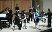 """Sospiro Vocal Ensemble featuring guest artist Esteli Gomez performing """"Songs of Mnemosyne"""" by W. Franklin Price. Andrew Stiefel, conductor. Photo: Gary Ferrington."""