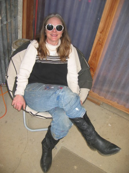"Sherry Pendarvis, whose farm hosts Pickathon, relaxes after putting the spring ""work party"" on a bird-preserving pause."