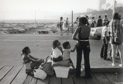 "Carrie Mae Weems, ""Mother with Children from Boardwalk, Santa Monica,"" 1980-82, Gelatin silver print, Courtesy of the artist and Jack Shainman Gallery, New York."