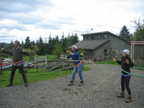 Volunteers enjoy a hula-hooping break.