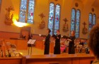 Anna Song led In Mulieribus's singers up the aisle to open the ensemble's May 5 concert.