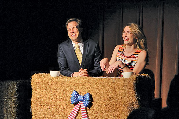 This isn't a hay bale, it's a news desk—one of several false fronts in Curious Comedy's latest.