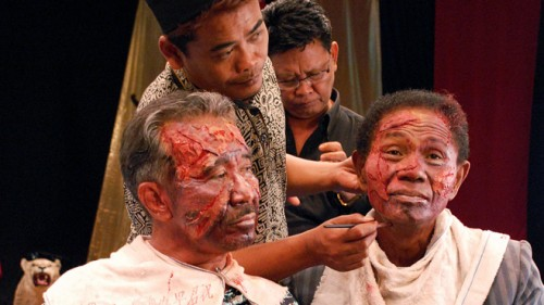 """The bad guys prepare for their shot in """"The Act of Killing"""""""