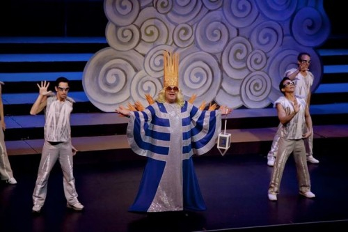 """Soloist Doug Bom and the Locomotions light the menorah during a Hannukah-themed version of """"Edge of Glory"""" during the 2011 Portland Gay Men's Chorus holiday concert. Photo: Bill Barry, BarryFoto©."""