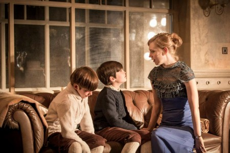 """The Young Vic's """"A Doll's House"""": Pip Pearce (left) and Arthur Gledhill Franks with Hattie Monahan as Nora. Photo: Johan Persson"""