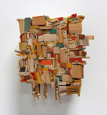Needle in the Timestack, 2014 paperback book slices, wood, bookbinder's adhesive