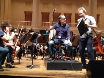 Fleck and Kalmar consult the score during rehearsal.