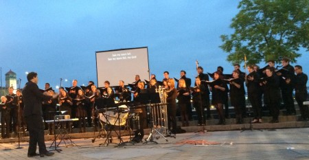 Ethan Sperry conducted the PSU Chamber Choir in Portland's Waterfront Park.