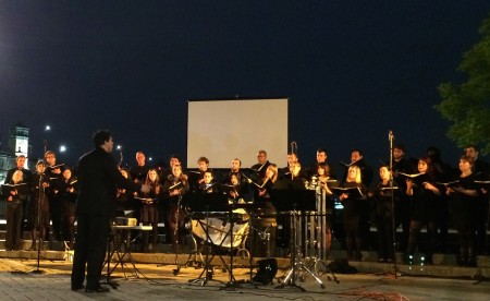 Ethan Sperry conducted PSU Chamber Choir on Portland's Willamette River waterfront two days after the church performance.