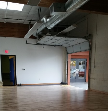 The refurbished Studio 1, with a new sprung floor, includes a wide garage-style door that opens to an outdoor courtyard. Photo: Subashini Ganesan