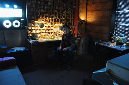 Artist D.E. May, who, by choice, works in relative darkness in his studio. Usually a thick blind is pulled down over the window in the left of this photo. /Sabina Poole
