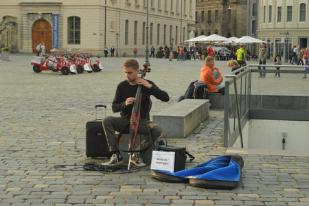 facebooking cellist with background