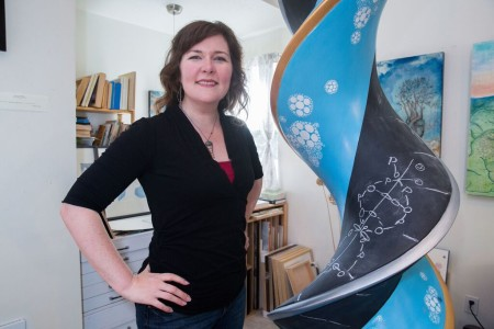 """Kindra Crick with """"What Mad Pursuit"""" in her Portland studio. Photo courtesy of artist."""