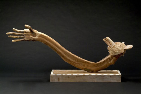 """From Nothing Coyote Creates Himself,"" 2004. Carved wood , 41 x 84 x 16 inches"