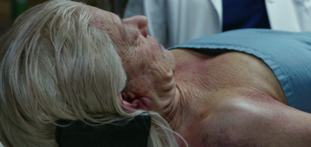 "The morgue scene in the ""Skin Deep"" episode of ""Grimm"" opens with a scary close-up of extra Cynthia Stowell after an amazing three-hour makeup and wig job. (Screen shot from NBC's ""Grimm."")"