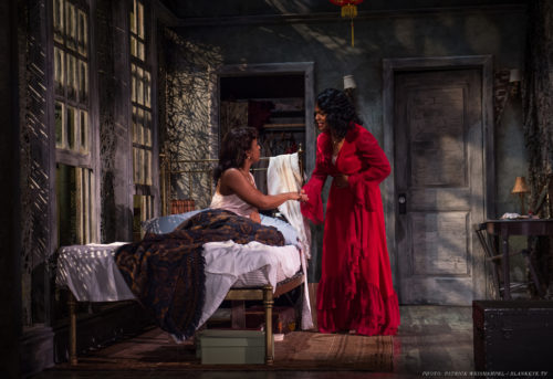Sisters, sisters: Stella (Kristen Adele, on bed) and Blanche (Diedrie Henry) have a heart-to-heart. Photo: Patrick Weishampel/blankeye.tv