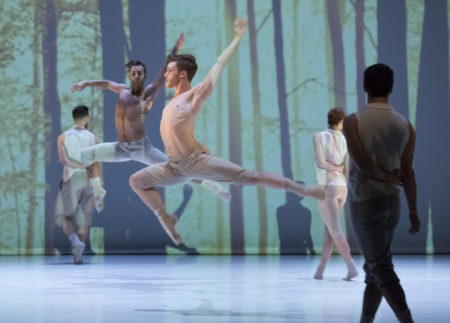 "Kody Jaron (foreground), Franco Nieto (background) and NW Dance Project company dancers in the world premiere of Carla Mann's ""We Were Wolves""/Photo by Blaine Truitt Covert"