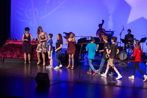 """The cast of Northwest Children's Theatre's """"Shrek: The Musical"""" rushes onstage to accept the award for best ensemble. Photo: David Kinder/kinderpics photography"""