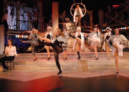 """The company kicks it up in """"Folies Bergere."""" Triumph Photography"""