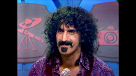 "Frank Zappa in a scene from ""Eat That Question"""