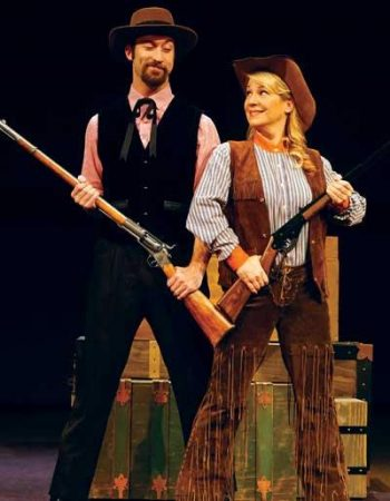 Guns galore at The Shedd this month in Irving Berlin's 'Annie Get Your Gun.'