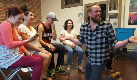 Ty Boice (right) rehearses a scene for Gigglefest with company members (from left) Megan Read, Katrina Brunette, Chris Forrer, and Tiffany Gilly. Photo by David Bates