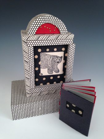 "Margo Klass' ""Ursa Major: The Great Bear in the Sky"" is a mixed media piece including a tacket-bound (exposed binding) book in box casement with sliding door and base."