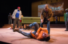 """Mark Murphey (holding book) plays William Joad, who meets unexpected relative Martin Jodes, played by Tony Sancho (on ground), in Octavio Solis' """"Mother Road"""" at Oregon Shakespeare Festival. Photo by: Jenny Graham/Oregon Shakespeare Festival"""