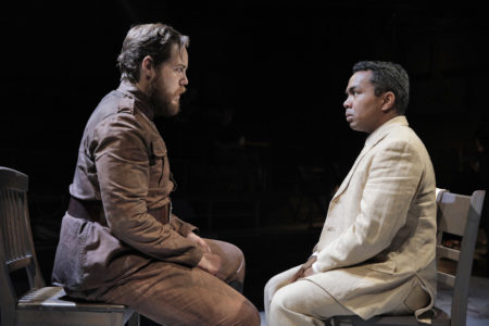 Ryan Thorn as The Officer and Martin Bakari as The Visitor in Portland Opera's new production of Philip Glass's In the Penal Colony. Photo by Cory Weaver.