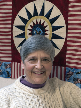"""Nan Scott will be the Featured Quilter at the 2019 Quilts by the Sea show.  Scott says she learned to sew on her grandmother's treadle machine, graduating to her mother's well-used pre-1935 Singer featherweight. """"Much of the enamel had chipped off,"""" she says, """"so I wore rubber soled shoes to avoid getting shocked when I used the machine."""""""