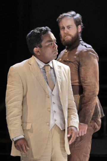 Martin Bakari as The Visitor and Ryan Thorn as The Office in Portland Opera's new production of Philip Glass's In the Penal Colony. Photo by Cory Weaver.