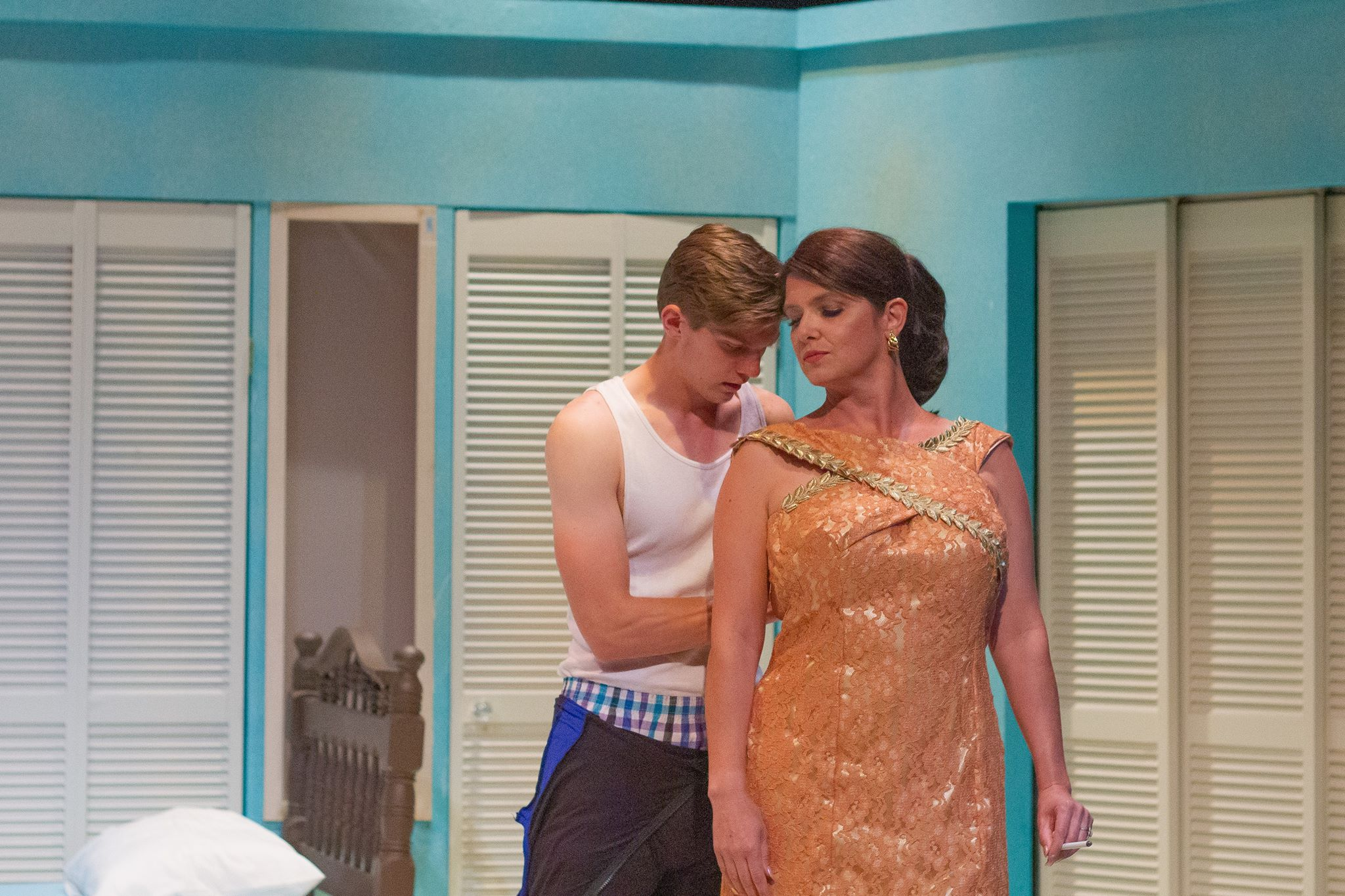 "Benjamin Braddock (John Davis Jr.) decides to follow the lead of Mrs. Robinson (Holly Spencer) in Gallery Theater's production of ""The Graduate,"" which opens Friday, July 26, in McMinnville. Photo by: EKay Media, courtesy Gallery Theater"