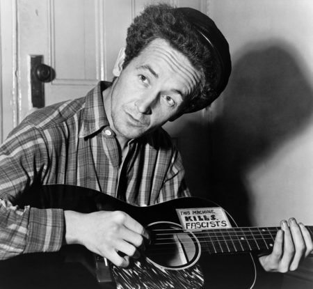 Woody Guthrie with antifa guitar.