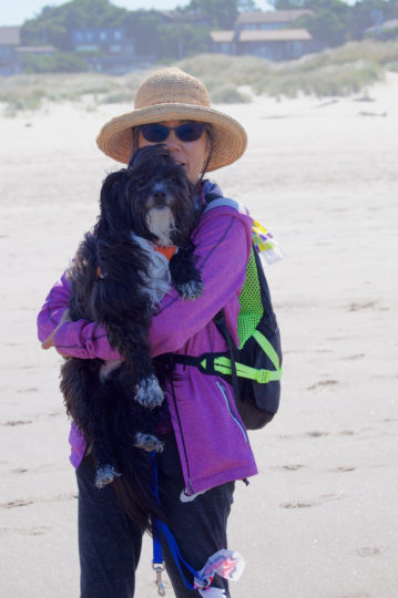 Artist Samyak Yamauchi and Dash, a 2-year-old rescue, both are fans of the beach.