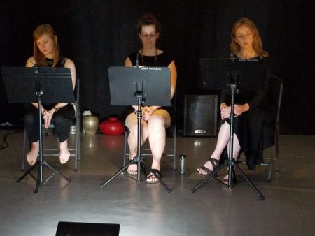 Annie Gilbert, Stephanie Lavon Trotter, and Margaret McNeal perform Angharad Davies' 'Cofnod Pen Bore' at Extradition's summer concert. Photo by Glenn Sogge.