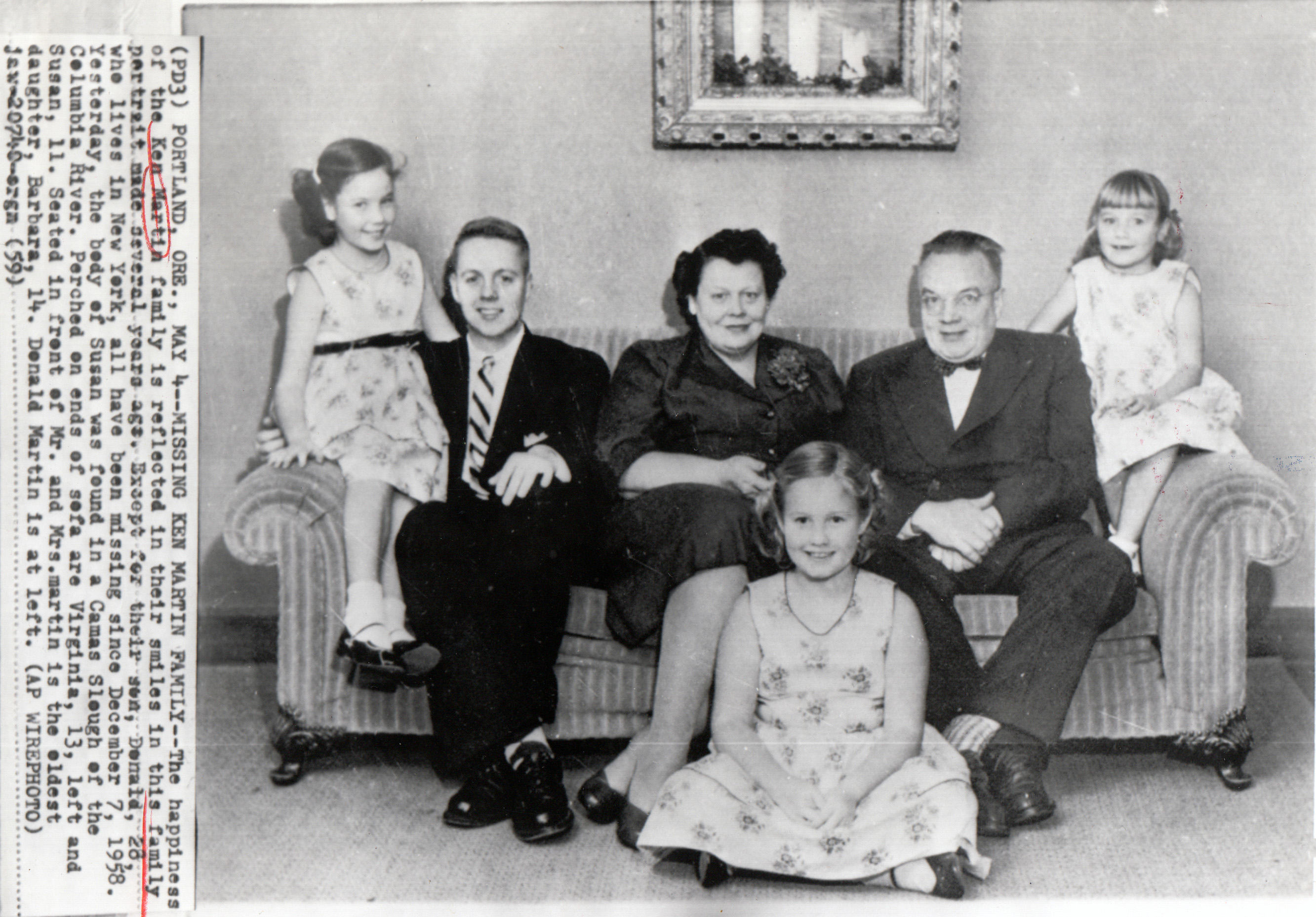 """""""The happiness of the Ken Martin family is reflected in their smiles"""" notes the caption of an AP Wirephoto published in May 1959, the day after the body of 11-year-old Susan (far right) was found in a Camas Slough. Other family members are (from left): Virginia, 13; son Donald (no age given); parents Barbara and Ken; and Barbara, 14 (seated on floor). Except for Donald, the family disappeared in December 1958 on a Christmas-tree outing. Photo courtesy: JB Fisher"""