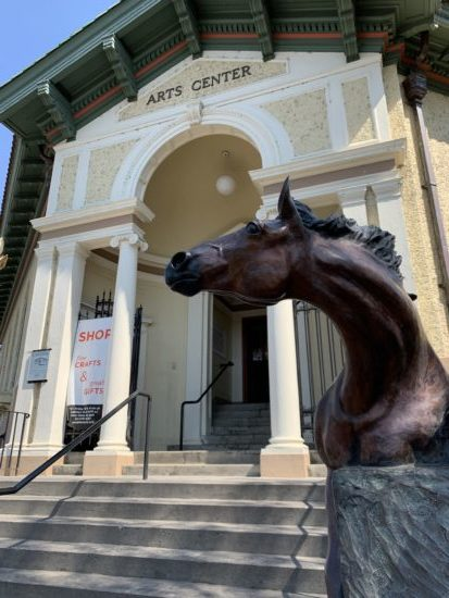 The entrance of the Carnegie library that houses the Pendleton Arts Center was designed to resemble the Pazzi Chapel at the Basilica di Santa Croce in Florence, Italy. Randy Gundlach's horse statue lends a western touch. Photo by: David Bates